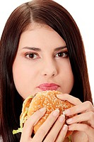 Beautiful caucasian woman eating hamburger
