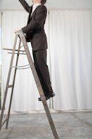Man in Suit Standing on Ladder