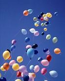 Sky balloons rising into the air