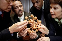 Businesspeople Examining Molecular Model