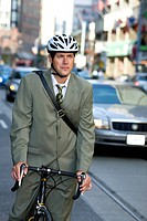 Businessman riding his bicycle, Toronto, Ontario