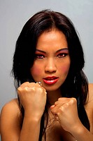 Beautiful Angry Asian Girl with Fists