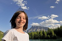 Young girl with Canadian Rocky mountains in background, Banff, Alberta