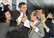 Businessman Being Congratulated