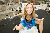 Young Woman in Lawn Chair on Rooftop
