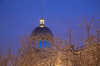 Illuminated dome at Bonsecours Market through ice_covered branches at dusk, Old Montreal, Quebec