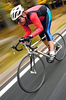 Cyclist Speeding Along Road