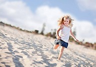 Adorable Little Girl Having Fun at the Beach