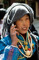 A Tibetan beauty using her mobile phone.