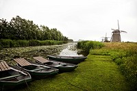 Smock Windmills and Rowboats Next to Irrigation Canal