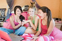 Teenage Girls Hanging out on Bed