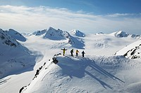 Skiers ready to take a run in the back country of whistler blackcomb, British Columbia, Canada.