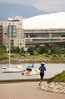 Jogging along False Creek, Vancouver, British Columbia, Canada.