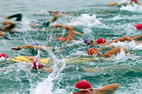Swimmers Competing in Triathalon
