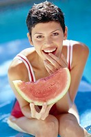Woman Eating Watermelon in Swimming Pool