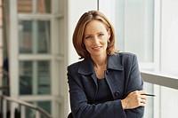 Businesswoman Smiling Near Window