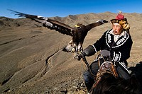 Pride! An Eagle hunter with his Golden Eagle