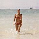 Woman walking in water at beach