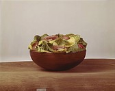 Bowl full of cabbage leaf and tomato slices, Close_Up