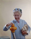 Senior woman pinching oranges, close_up