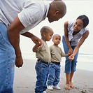 Parents with Twin Sons at Beach