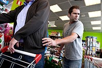A pickpocket tries to steal a wallet or any other good in a supermarket