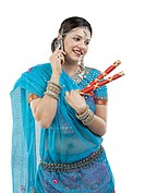 Gujarati woman talking on a mobile phone