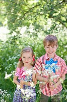 Children playing with pinwheels outdoors