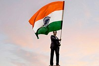 Businessman holding the Indian flag