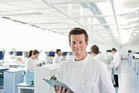 Scientist using clipboard in lab