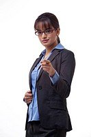 Portrait of confident female executive pointing at you over white background