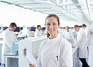 Scientist with clipboard in lab