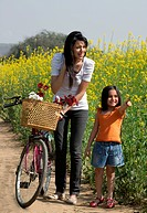 Mother and daughter enjoying in a field