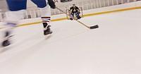 Hockey Player Skating Toward Goal