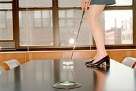 Businesswoman Putting on Conference Table