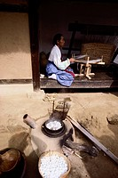 Artisan Spinning Silk Thread the Traditional Way