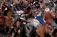 Afghan horsemen play the traditional game of Buzkashi.