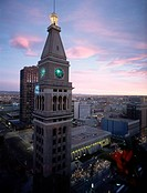 A clock tower stands in downtown Denver, Colorado, among city buildings.