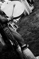 Native American Beating on a Drum