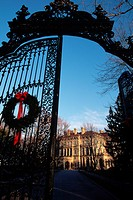 A Christmas wreath hangs from the ornate iron gateway of The Breakers, the summer cottage of Cornelius Vanderbilt II. Newport, Rhode Island.