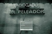 American Flag Poster Under Store´s Neon Sign
