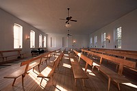 Pews fill the stark interior of the Amana Colony church in Homestead. Homestead is one of the seven villages that comprise the Amana Colonies in Iowa,...