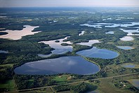 A aerial view of several lakes north of Brainerd, Minnesota in the late afternoon.