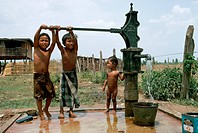 Children Pump Water At Village Pump, Thailand