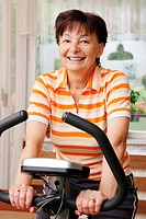 Spinning senior woman