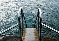 Steel steps leading to coastal rock pool on Gran Canaria