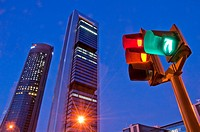 Traffic light and Four Towers, night view. Madrid, Spain.