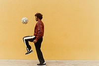Man Bouncing Soccer Ball on Knee