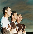 Baseball Players Holding Caps over Hearts