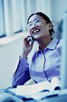 Businesswoman Using Cell Phone at the Office